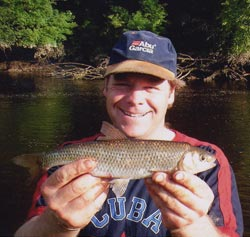 A smiling Terry Jackson with his 0.362kg dace from the River Nore, August 2002.
