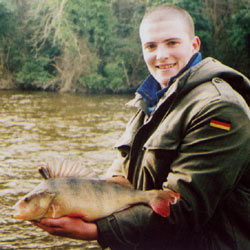 Gary Doyle with a 3 lb 6 oz perch from the River Barrow, February 2003