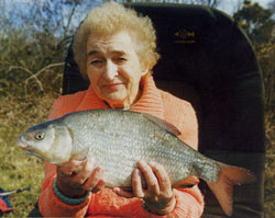 10 Pin Award winner Eileen Coulter with one of her trio of roach/bream hybrids from the River Bann in March 2003