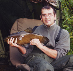 Mark Healy poses with one of his better specimen tench.